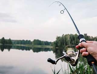 Риболовля зі спінінгом - фото darunok.ua