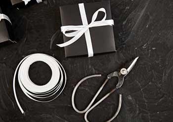 Упакований подарунок - фото Дарунок