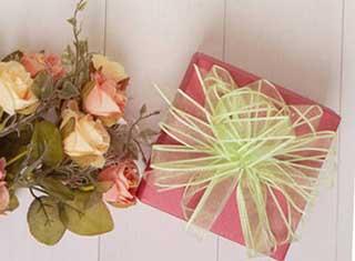 Красивая упаковка подарка Тельцу девушке - фото Дарунок